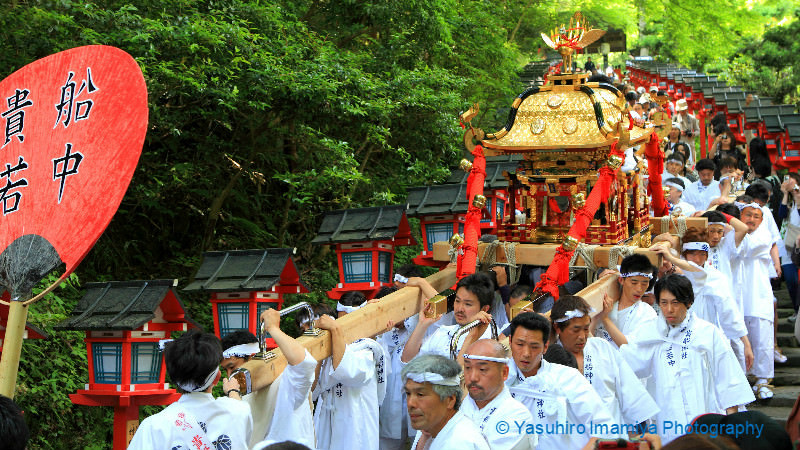 "Carrying the portable shrines called ""Mikoshi"""