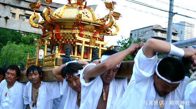 Portable shrines called Mikoshi