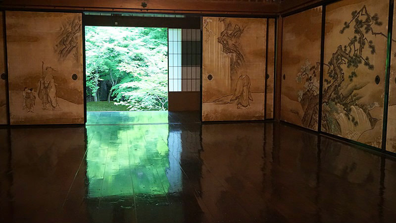 Maple leaves reflected on the floor of the temple