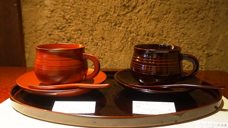 A coffee cup with saucer and spoon