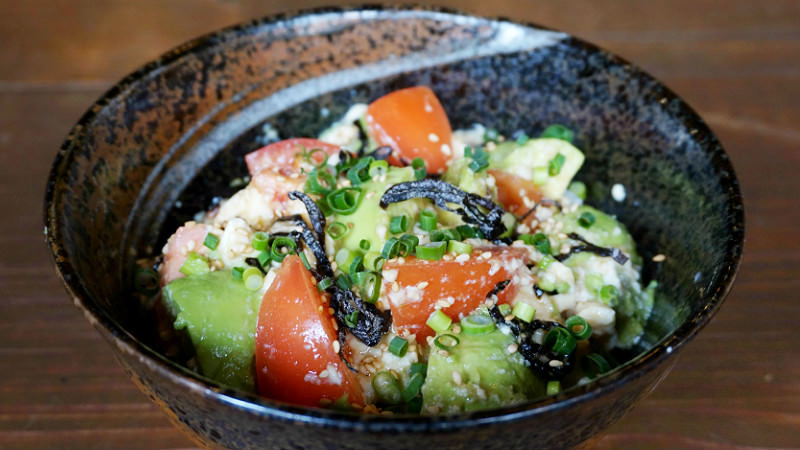 Bowl of rice with avocado, tomatoes, kelp, and Tofu