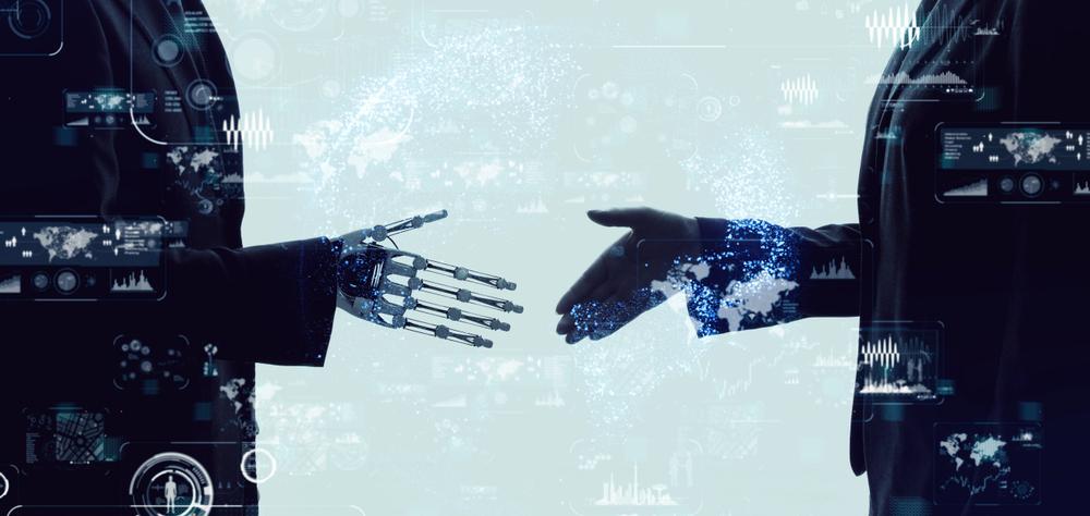 握手をするロボットと人間