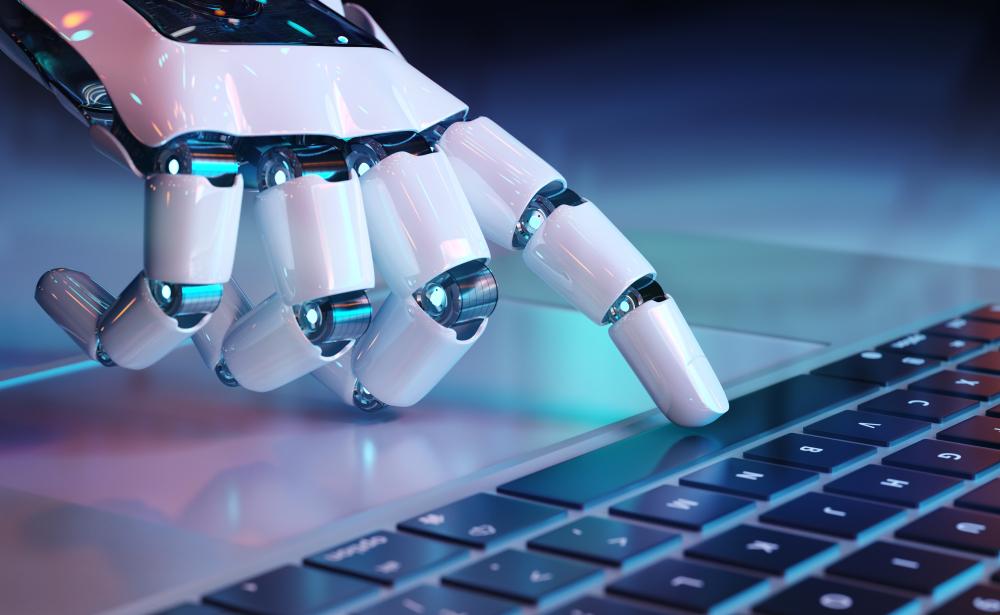 キーボードを操作するロボットの手