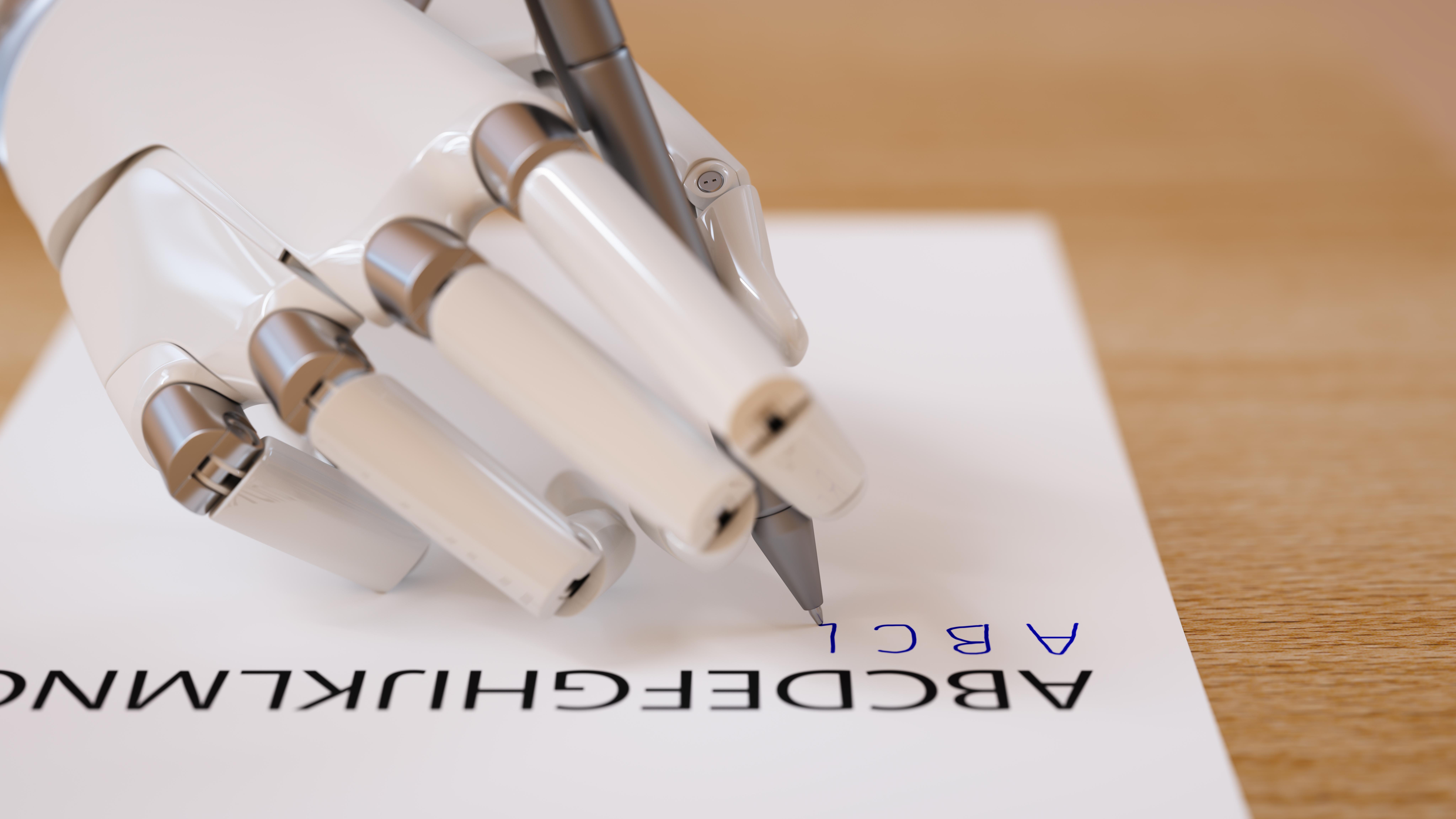 ロボットの手がアルファベットを書く様子
