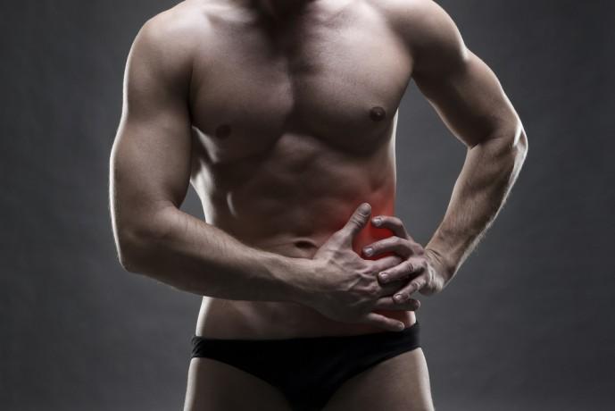 筋肉痛のある男