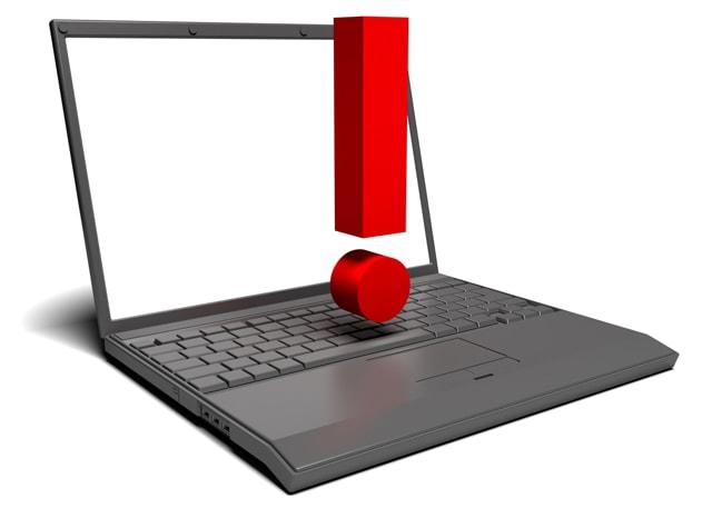 パソコンの上にビックリマークが載っているイラスト