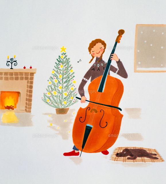 クリスマスの夜コントラバスを弾く女性02237005719の写真素材