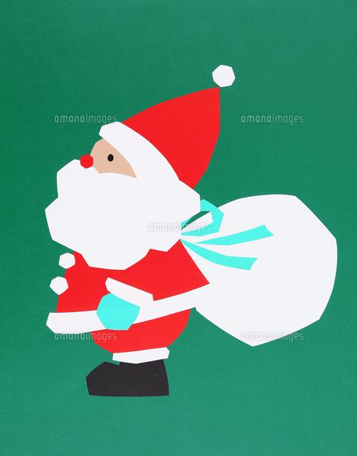 クリスマスプレゼントの袋を背負うサンタクロース の写真素材 イラスト素材 アマナイメージズ