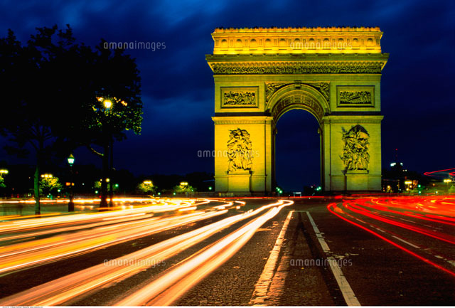 arc de triomphe and light trails on road at night paris 20025014287