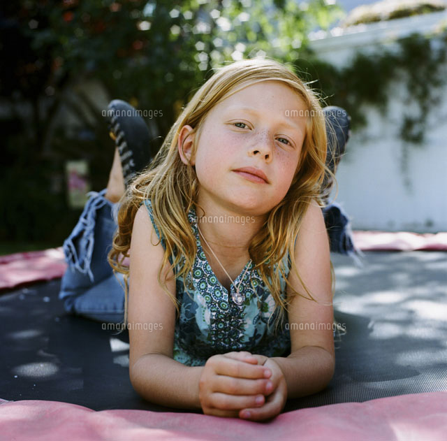 girl on trampoline costa mesa california usa 20025265776. Black Bedroom Furniture Sets. Home Design Ideas