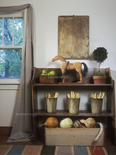 collection display country living room detail of shelf with