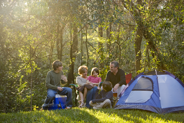 portrait of family together on camping trip at campsite 20025384801