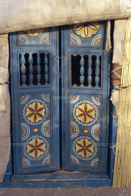 close up of decorated blue wooden doors to a yurt at repeter