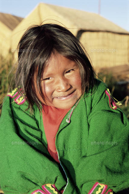 head and shoulders portrait of a uros indian girl on floating reed