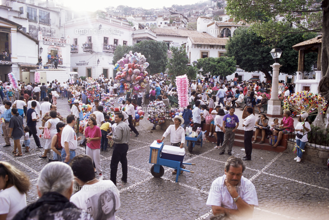 ice cream vendor in middle of crowds during easter celebratioans