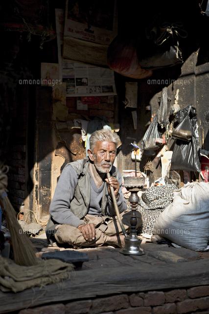 old man with pipe bhaktapur kathmandu valley nepal asia