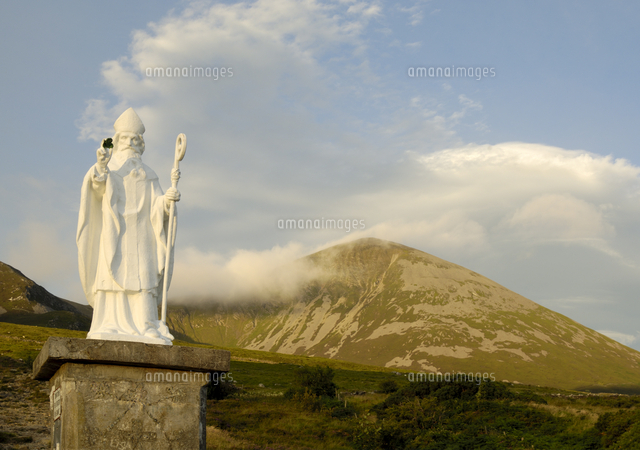 statue of st patrick at the base of croagh patrick mountain county
