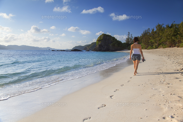Woman walking on Furuzamani Beach, Zamami Island, Kerama Islands, Okinawa, Japan, Asia
