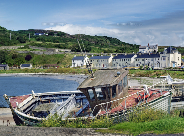 view of fishing boat at coast mountains and building in rathlin