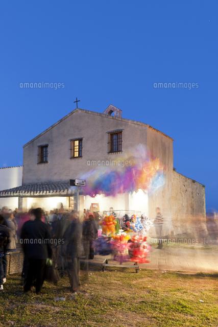 people at sant efisio church at blue hour nora cagliari sardinia