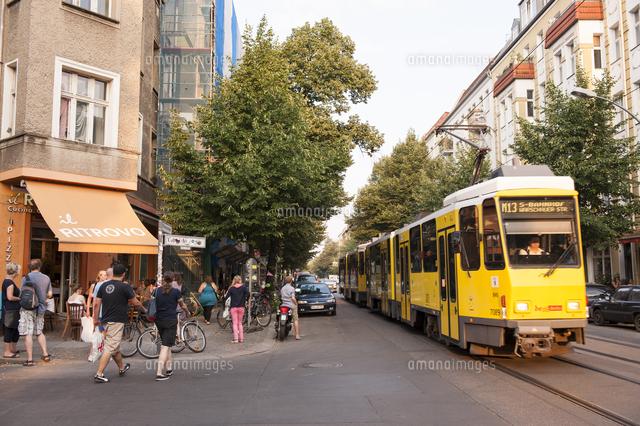 yellow trum with people on street in friedrichshain berlin germany