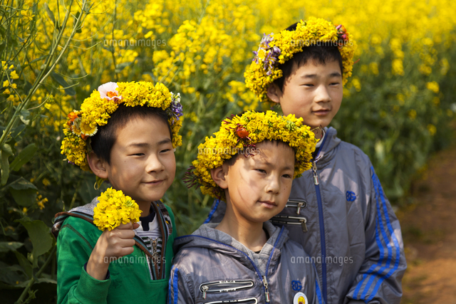 china yunnan luoping chinese children enjoying the flowers in the