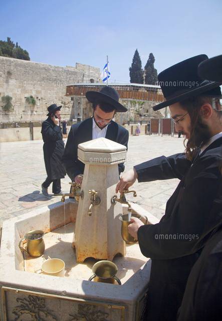 Israel, Jerusalem. Jews washing their hands before entering for mourning and praying at the Western