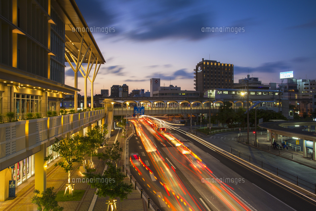 Traffic passing Asahibashi monorail station in downtown Naha, Okinawa, Japan