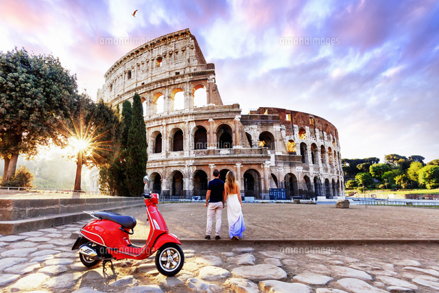 italy rome a young couple on a red vespa motorbike enjoying the