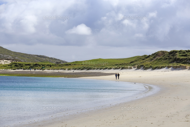 scotland western isles vatersay two people walking along the
