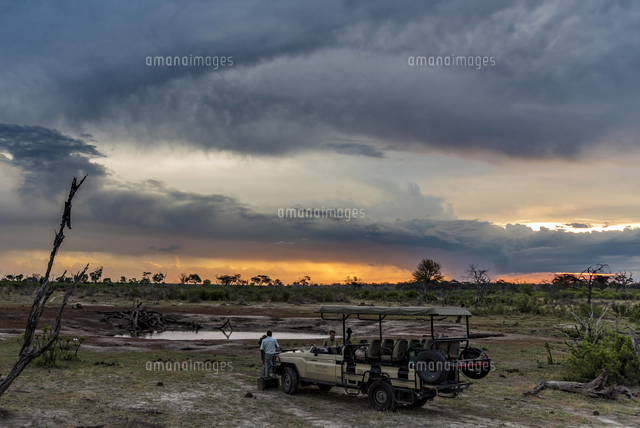Africa, Zimbabwe, Hwange National park.  A stop for a sundowner at a waterhole during an afternoon g