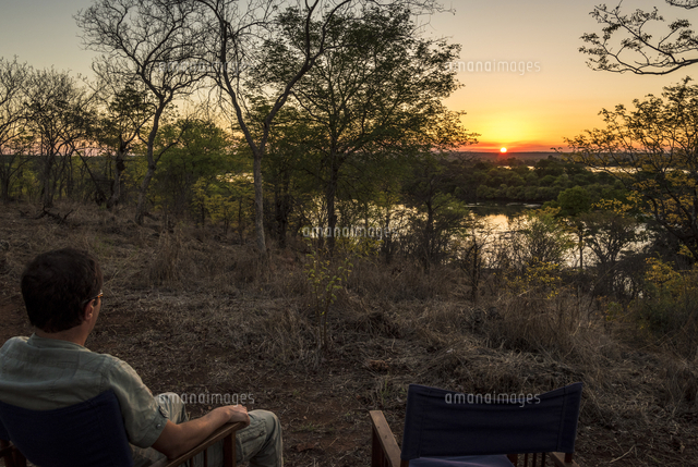 Africa, Zimbabwe, Matabeleland north. Sundowner in the Zambezi National Park looking out over the Za
