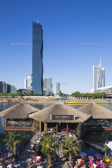Austria, Vienna, Donau City, People at Sunken City bar area next to the New Danube river