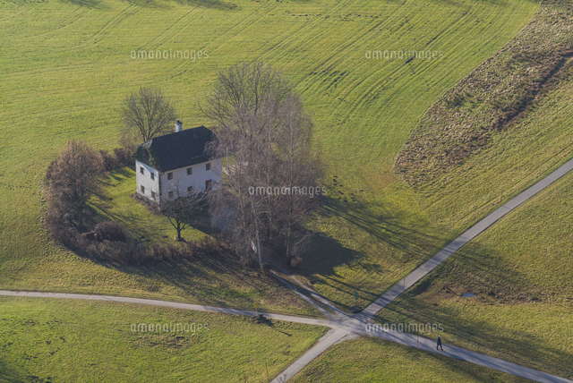 Austria, Salzburgerland, Salzburg, elevated view of house in field, winter