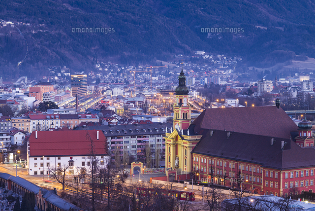 Austria, Tyrol,  Innsbruck, elevated view of the Wilten Abbey Church, dawn, winter