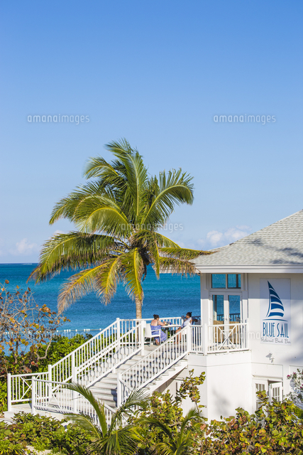 Caribbean, Bahamas, Providence Island, People sitting on balcony of Blue Sail restaurant