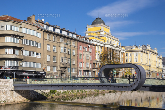 Bosnia and Herzegovina, Sarajevo, Buildings on the banks of the Miljacka River, and Festina Lente br