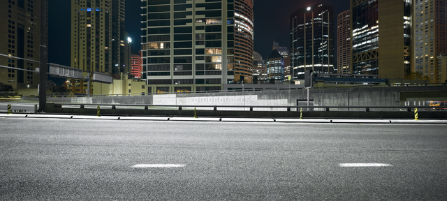 inner city freeway with office blocks night side on 20093000143