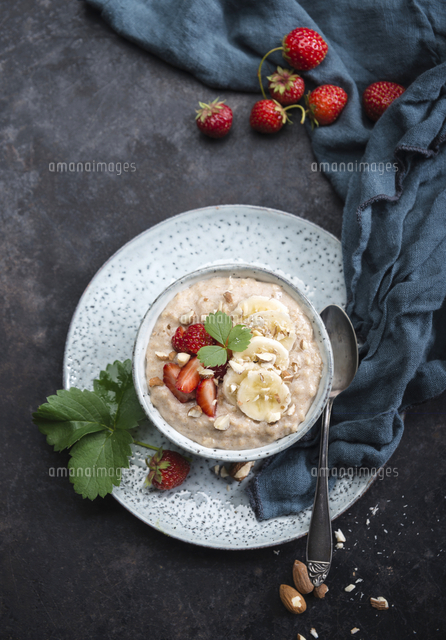 Vegan spelt porridge with almond milk, bananas, strawberries and almonds