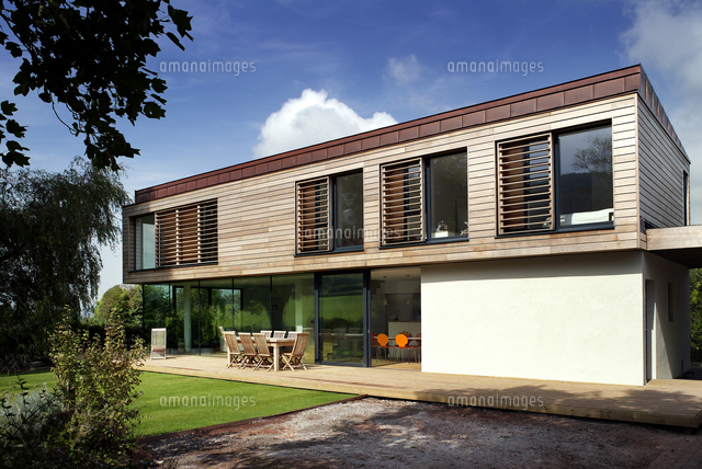Modernist House With Outdoor Furniture On Terrace In Trees  Ubly, Somerset,  UK (