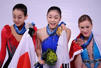 Mao Asada of Japan receives the silver medal, Kim Yu-Na of South Korea receives the gold medal and J