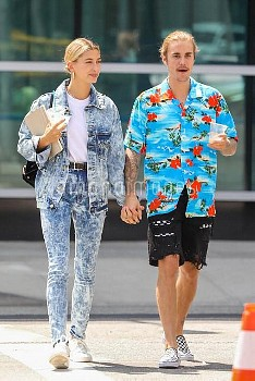Justin Bieber and Hailey Baldwin hold hands as they walk in Beverly Hills