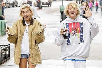 Justin Bieber and Hailey Baldwin have fun with the cameras in their matching hair styles