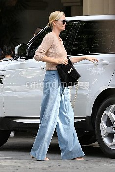 *EXCLUSIVE* Charlize Theron looks trendy as she brings her kids to lunch