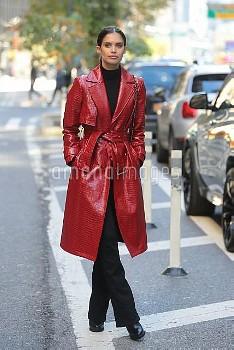 Sara Sampaio draws eyes in her attention-grabbing  maroon rich trench coat