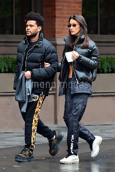 Bella Hadid and The Weeknd are hand in hand as they step out during a rainy day in NYC