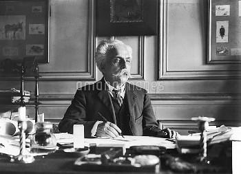 LRS189407 Gabriel Faure (1845-1924) at his desk (b/w photo) by Dornac (Paul Francois Arnold Cardon)