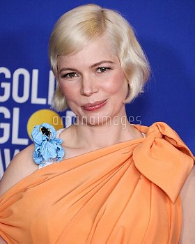 Actress Michelle Williams wearing Louis Vuitton poses in the press room at the 77th Annual Golden Gl