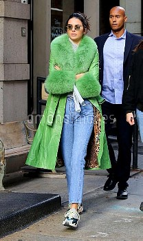 Kendall Jenner goes on a CitiBike ride wearing a green fur coat on her 23rd Birthday in Manhattan's