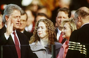 BILL CLINTON being sworn in at second inauguration, Chelsea Clinton(c), & Hillary Clinton(r), Januar